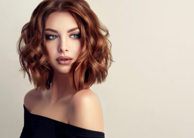 Attractive brunette woman with modern, trendy and elegant hairstyle.