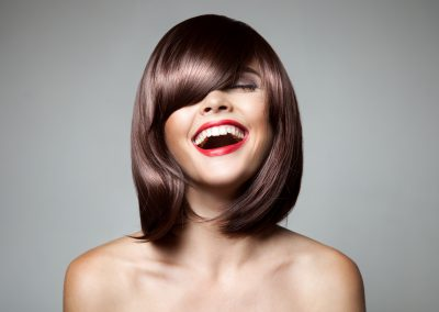 Smiling Beautiful Woman With Brown Short Hair. Haircut.